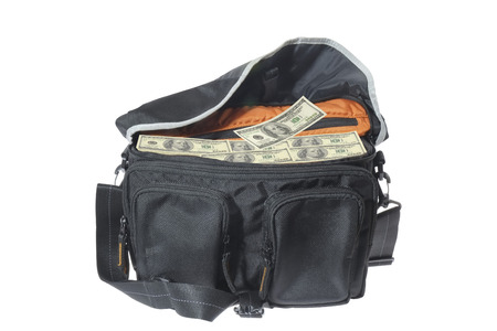 transfer pricing: Hundred-dollar bills in the bag  Stock Photo