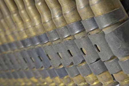 cartridge belt: Close up chain of cartridges, used. Stock Photo