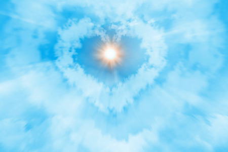 Heart shaped cloud with the sun on blue sky. photo