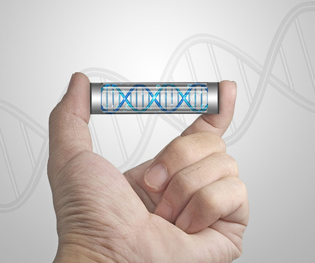 Capsule of DNA in hand. photo