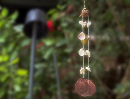 clam gardens: Seashell mobile hang on the garden.