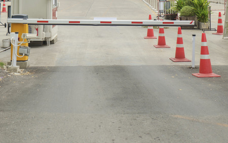 security barrier: Security barrier of entry to parking lot. Stock Photo