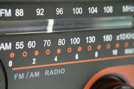 Close up of radio tuner dial scale.