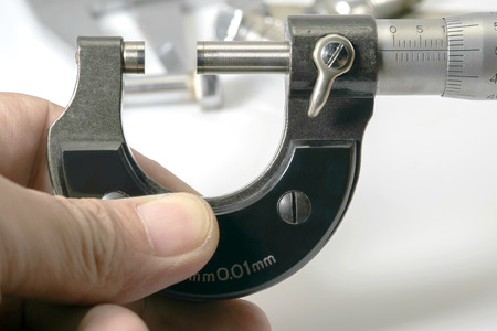 micrometer: Used and dirty micrometer, device used to tiny measurements.