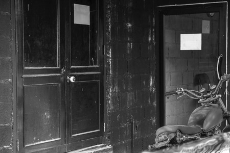Black and white of door was closed, selected focus on doorknob. photo
