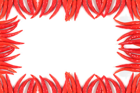 hot frame: Frame of hot red chili on white background. Stock Photo