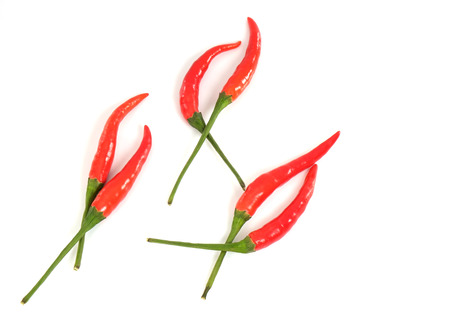flavorings: Hot red chili on white background.