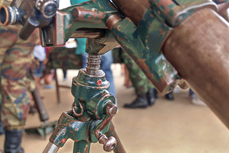 adjustment: Close up screw height adjustment of old artillery gun.