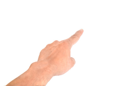 Human hand pointing on white background. Select focus on fingertip. photo