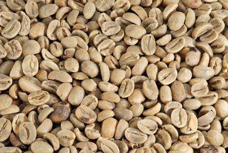 unprocessed: Raw coffee beans texture background. Stock Photo
