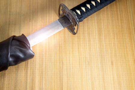 sheath: Japanese samurai sword and sheath on bamboo background.