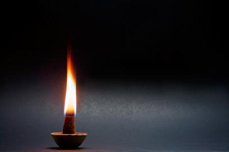 frankincense: Frankincense flame on black background. Dark tone.