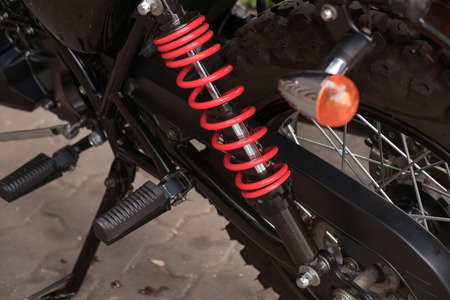 footrest: View of motorcycle footrest and red absorber.
