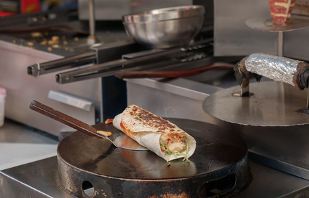 kabob: Chicken kabob roll on flat pan.