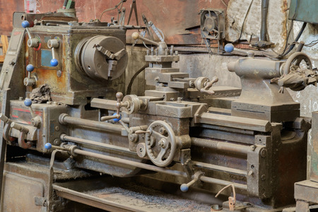 lathe: Old and dirty lathe machine. Stock Photo