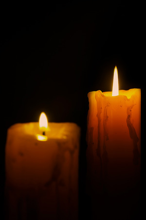 candle light: Candle light on black background.