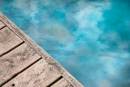 reflex: Waterfront walkway made of wood and reflex of building. Stock Photo