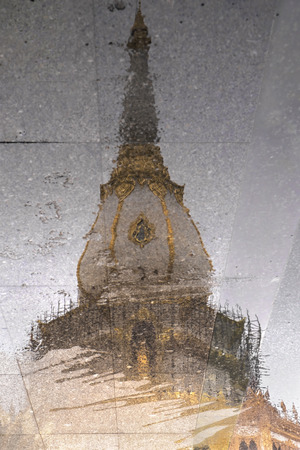 water stain: Pagoda reflected on a water stain.