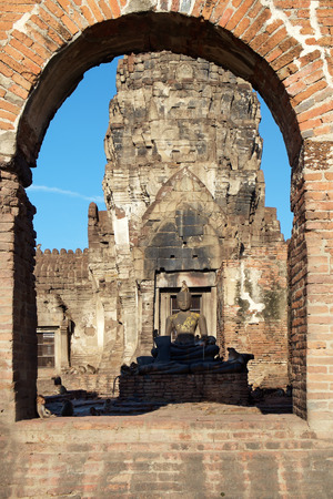 conglomeration: Ruins and Buddha with monkeys, Lopburi, Thailand.