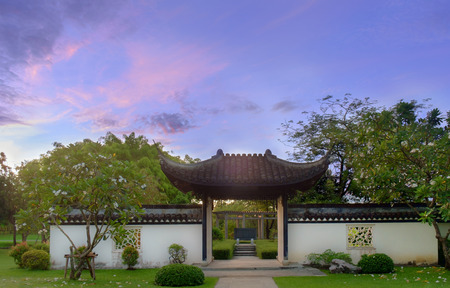 asian gardening: Pavilion of public park chinese style in the morning on blue sky background.