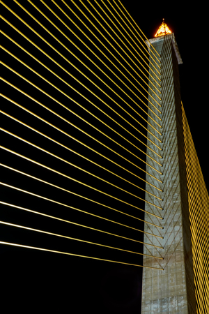 slings: Image of slings stretched on the Rama 8 bridge at night, Bangkok, Thailand.