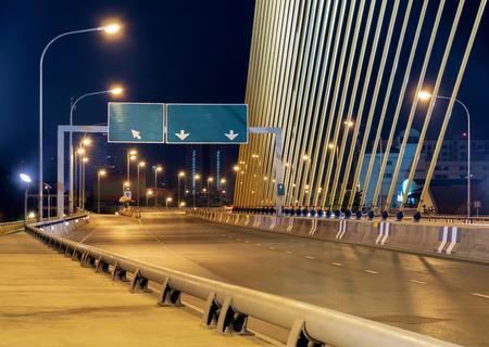 crossway: Image of crossroad on Rama 8 bridge at night, Bangkok, Thailand. Stock Photo