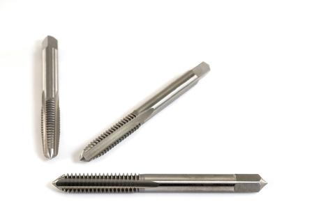 threading: Hand tap (threading tool) on white background.