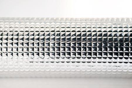 foil roll: Roll of aluminum foil on white background.