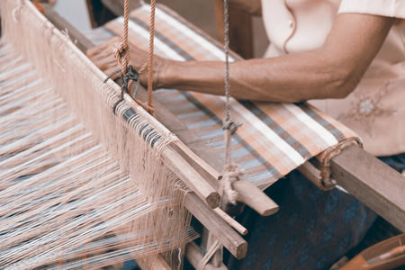 cloth manufacturing: Close up of weaving. Vintage style picture.