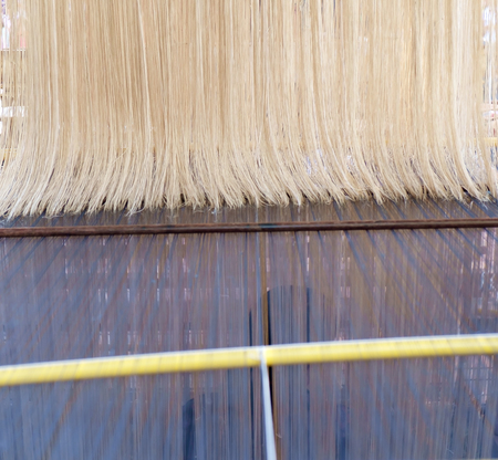 loom: Close up thread on loom. Stock Photo