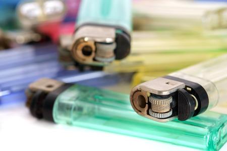 cigarette lighter: Close up cigarette lighter on white paper background.