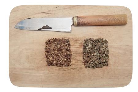 spliff: Marijuana, tobacco and knife on wood background.