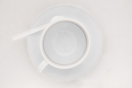 coffee stains: Empty coffee cup with coffee stains on white background. Top view. Stock Photo