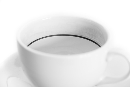 coffee stains: Close up empty coffee cup with coffee stains on white background. Black and white tone.