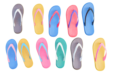 informal clothes: Colorful rubber shoes on white background. Top view.