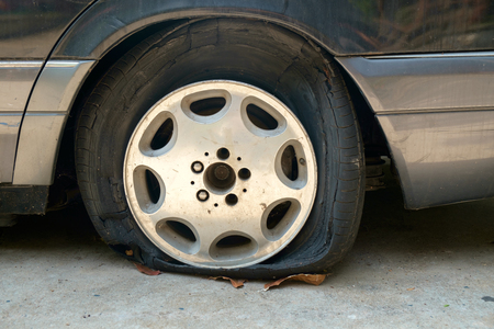 abandoned car: View of flat tires of car was abandoned.