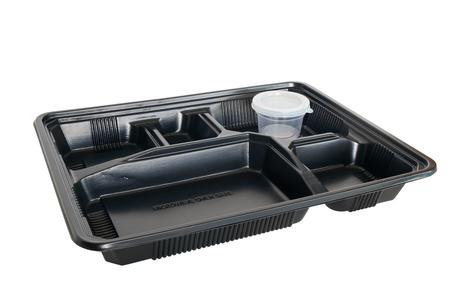 Plastic voedsel container op een witte achtergrond. Stockfoto