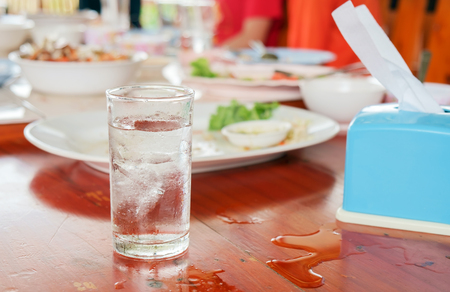 repast: View of glass of water on table in restaurant. Stock Photo