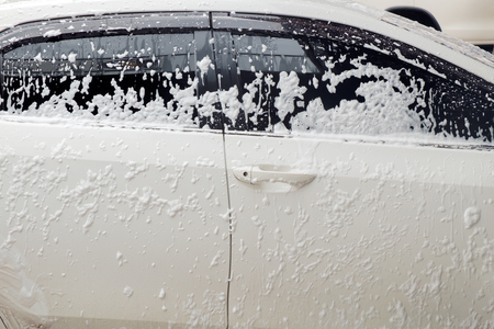 cleaning car: Cleaning car with foam at car wash shop. Stock Photo