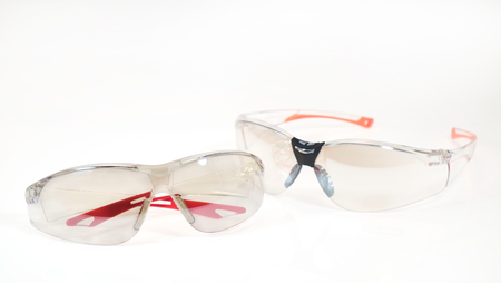 View of safety glasses on white background.  Protection devices for industrial applications. Stock fotó