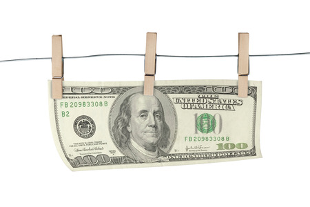 household money: Wooden clothespin and hundred dollar bill on white background. Business concept.