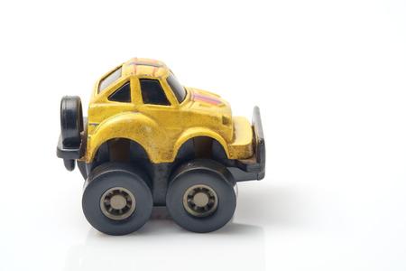 yellow car: Toy yellow car on white background. Stock Photo