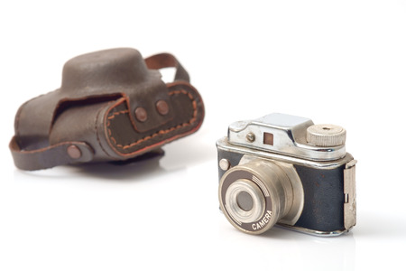 tiny lenses: Vintage toy, camera on white background.