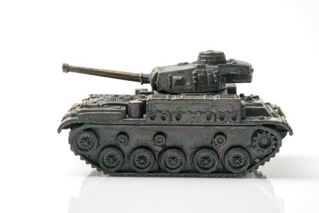 Vintage toy, military tank on white background.