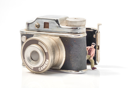 tiny lenses: View of miniature toy people and camera.