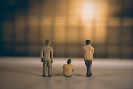 people in action: View of miniature toy peoples watch sunset. Vintage style.