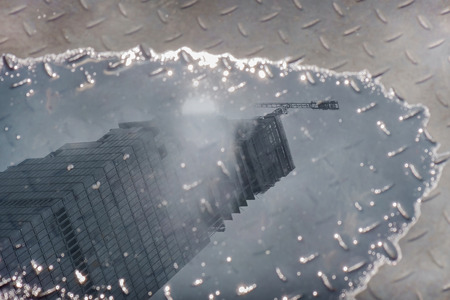 water stain: Building reflected on a water stain.