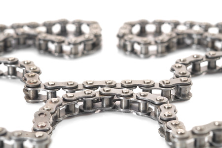 View of dirty roller chain on white background.