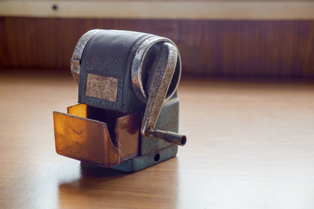 old desk: View of old and dirty sharpener on desk office.