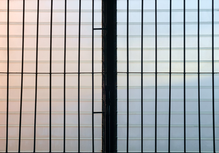 louver: Silhouette of dirty louver window at twilight.